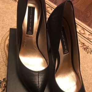 Black leather heels.